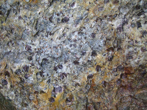 a photo of garnets in the schist at the mine, waiting to be mined.